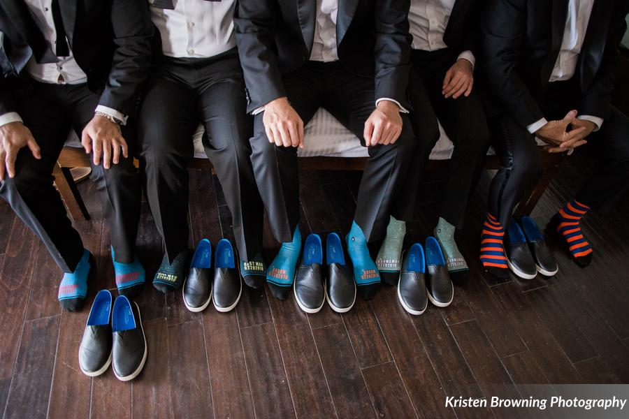 Groomsmen in The Florida Keys wearing unique & colorful socks.