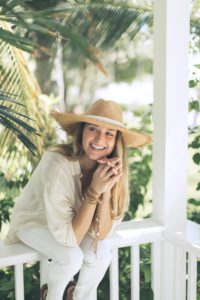 Florida Keys wedding planner laughs among tropical greenery.